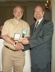 Laurence Duncan, on behalf of James R. Bakes receiving the Guy Potter Literary Award for the best article in The CN Journal from Tim Henderson