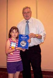 Sabrina Boyer receiving Medals of British India by Robert Puddester from Charles Moore, President of the C.N.A.