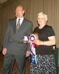 Tim Henderson presenting the Best of Show Award to Dorte Brace