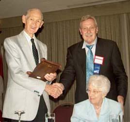James Charlton receiving a Presidental Award from Chuck Moore