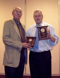 Bret Evans receiving a Presidental Award from Chuck Moore