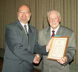 Tim Henderson presenting the Fellow of the C.N.A. Award to George Fraser
