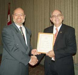 Tim Henderson presenting the Fellow of the C.N.A. Award to Dan Gosling