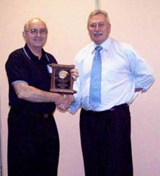 Dan Gosling receiving a special appreciation award from Charles Moore, President of the C.N.A.