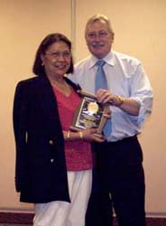 Monina Regitko receiving a special appreciation award from Charles Moore, President of the C.N.A.