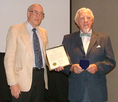 Ron Greene presenting the J. D. Ferguson Award to Freeman Clowery