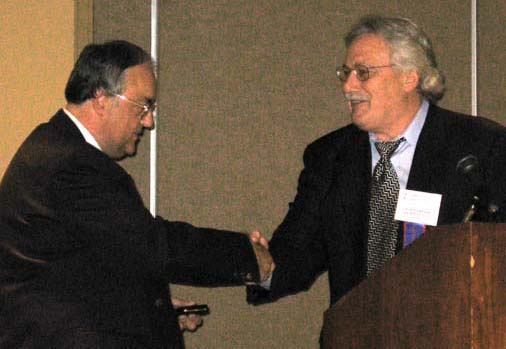 Paul Johnson receiving a President's Award from Charles Moore, President of the C.N.A.