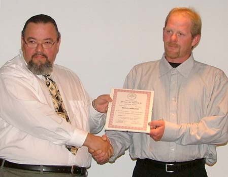 Tim Henderson presenting the Jerome H. Remick III Literary Award for the best numismatic article published in a local Canadian coin club newsletter during the previous calendar year to Troy Carlson