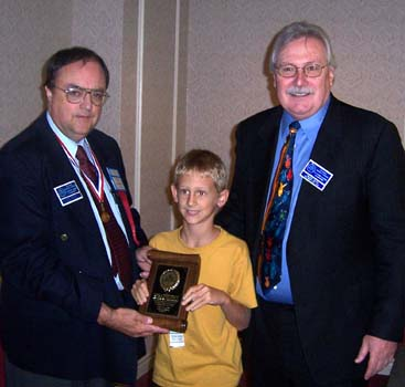 Matthew Van Brunschot receiving a Presidential Award