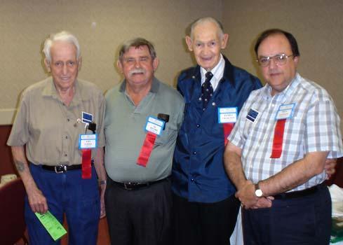 Les Copan, Al Munro, James Charlton, Honorary President of the C.N.A.; Paul Johnson, C.N.A. Executive Secretary