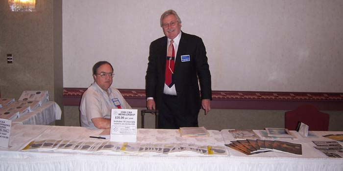 Paul Johnson, C.N.A. Executive Secretary; Charles Moore, C.N.A. President, at the C.N.A. Information Table