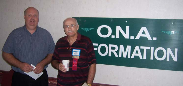 unknown, Tom Rogers at the Ontario Numismatic Association information desk