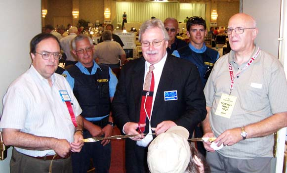 Paul Johnson, C.N.A. Executive Secretary; Charles Moore, C.N.A. President, John Regitko, Convention Chairman, at the Ribbon Cutting Ceremony opening the 2006 C.N.A. bourse floor to the collecting public