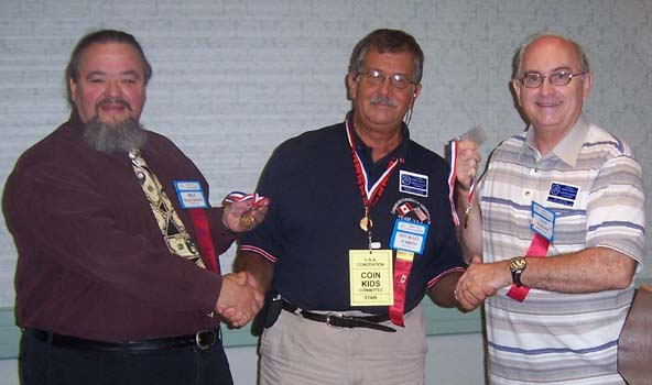 Bill Waychison (left) and Dan Gosling (right) , received a Carmody-Lebo Citation for service to the hobby from Michael Turrini (center)