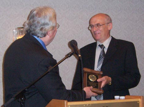 Bret Evans receiving a Presidential Award on behalf of Trajan Publishing for ongoing support of the C.N.A.