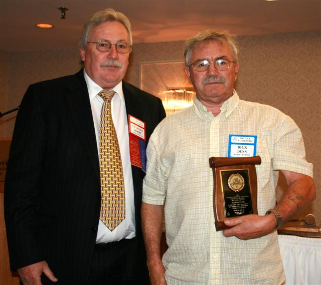 Dick Dunn receiving a Presidential Award for his ongoing support of the C.N.A.