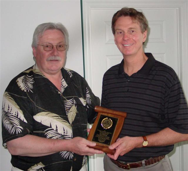 Paul Winkler receiving a Presidential Award for his ongoing support of the C.N.A.