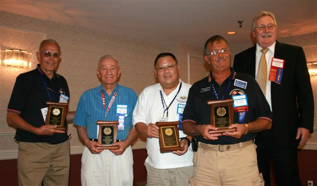 Jim Majoros, Fred Freeman, Lee Gong, Michael Turrini receiving Presidential Awards for their ongoing support of the C.N.A.