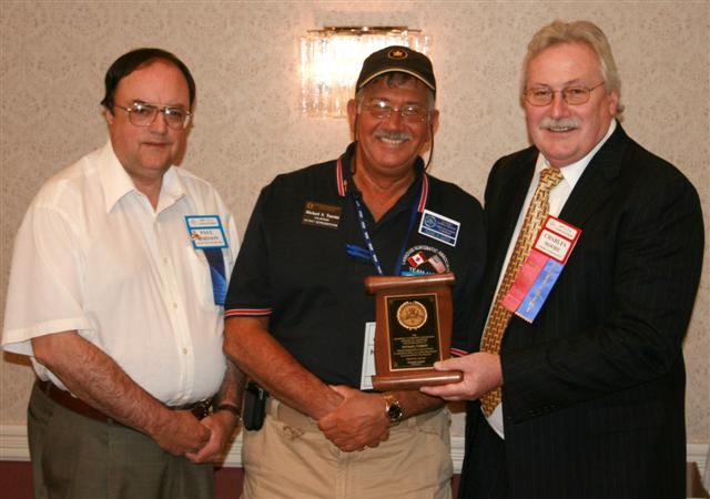 Michael Turrini receiving a Presidential Award for his ongoing support of the C.N.A.