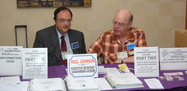 Paul Johnson, C.N.A. Executive Secretary, and Stan Clute at the C.N.A. Booth