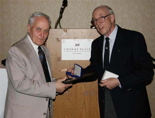 Jean-Pierre Paré receiving the J. D. Ferguson Award from Ron Greene, Chairman of the Ferguson Board of Award