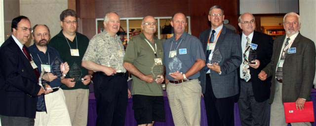 Paul Johnson, Henry Nienhuis, Victor Shewchuk, Doug Andrews, Tom Rogers, Vic Schoff, Steve Woodland and Dan Gosing receiving Presidential Awards