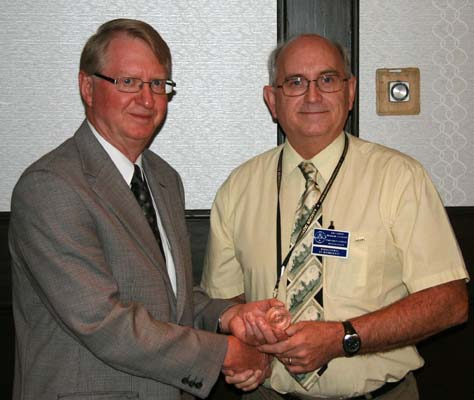 Cliff Beattie presents Dan Gosling with a C.P.M.S. Service Award for his prior and ongoing work in digitizing past issues of the C.P.M.S. Newsletter and Journal