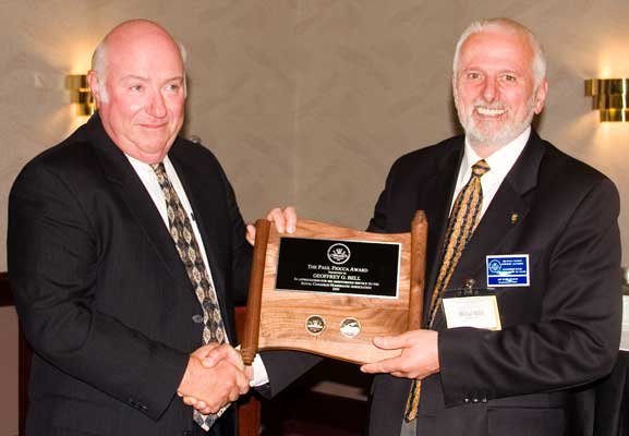 (left to right) Geoffrey G. Bell receiving the Paul Fiooca Award from Michael Walsh