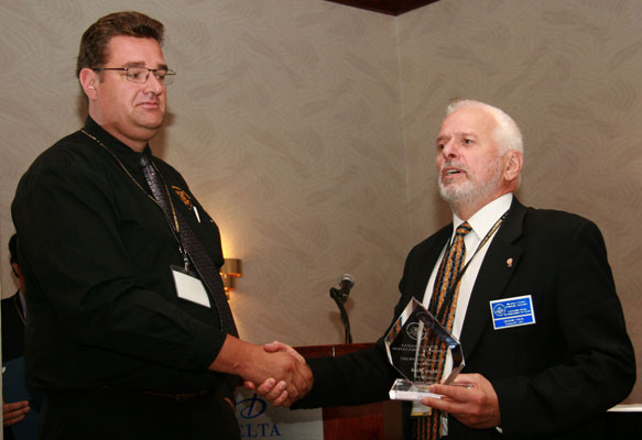 Marc Bink receiving a Presidential Award from Michael Walsh, President of the RCNA