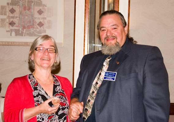 (left to right) Geraldine Chimirri-Russell receiving a Fellow of The Royal Canadian Numismatic Association Award from Bill Waychison
