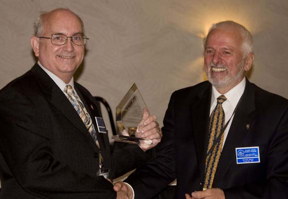 Daniel Gosling receiving a Presidential Award from Michael Walsh, President of the RCNA