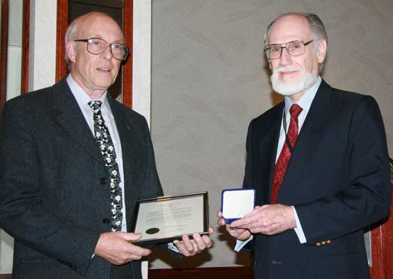 (left to right) Ron Greene, Chairman of the Ferguson Board of Award presenting the J. Douglas Ferguson Award to Robert P. Puddester