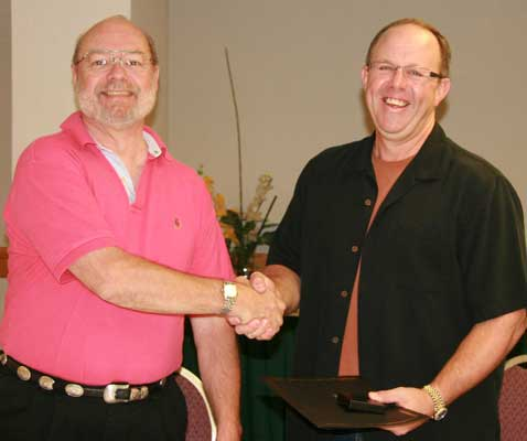 (left to right) Tim Henderson presenting a Fellow of The Royal Canadian Numismatic Association Award to Vic Schoff, F.R.C.N.A.