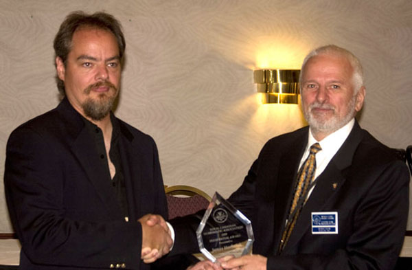 James Horkulak receiving a Presidential Award from Michael Walsh, President of the RCNA