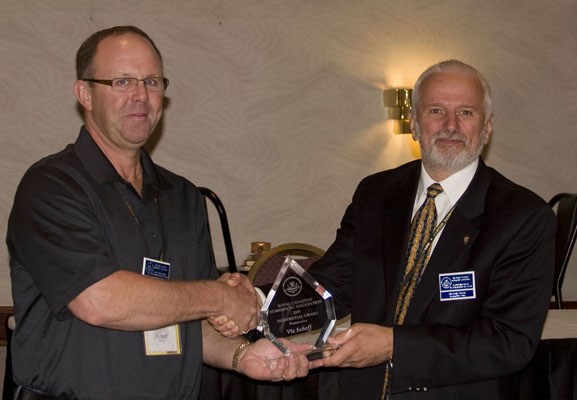 Vic Schoff receiving a Presidential Award from Michael Walsh, President of the RCNA