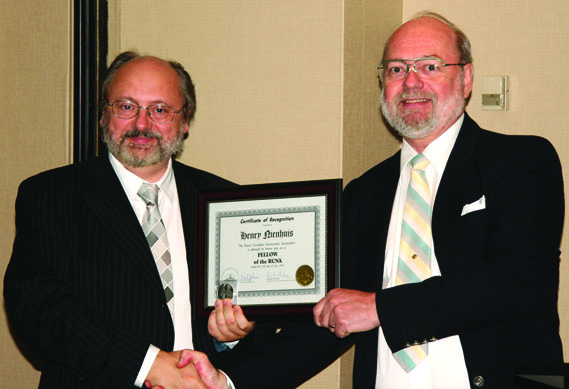 (left to right) Henry Nienhuis receiving a Fellow of The Royal Canadian Numismatic Association Award from Tim Henderson, F.R.C.N.A.