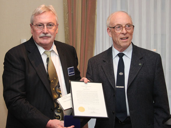 Charles D. Moore (left) receiving the J. Douglas Ferguson Award from Ron Greene (left)