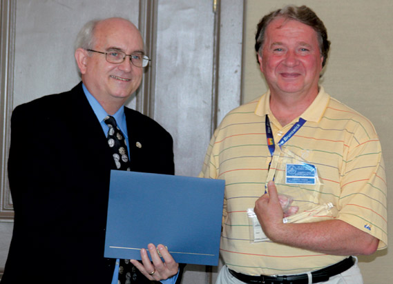 Todd Hume receiving a Presidential Award from Michael Walsh, President of the RCNA