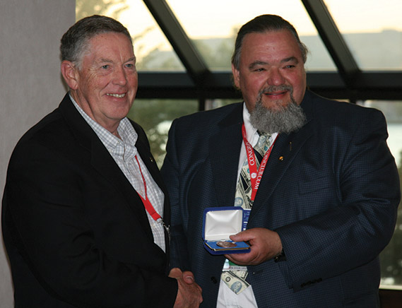 Ron Cheek (left) receiving theJerome Remick III Literary Award from Bill