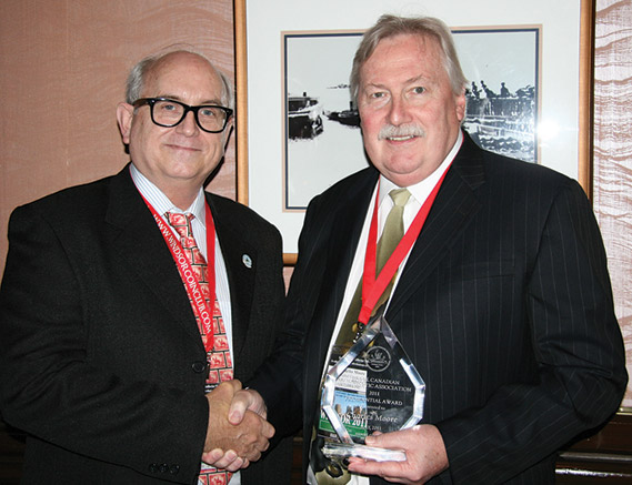 Charles Moore (right) receiving a Presidential Award from Dan Gosling, President of the RCNA