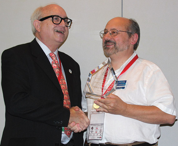 Henry Nienhuis (right) receiving a Presidential Award from Dan Gosling, President of the RCNA