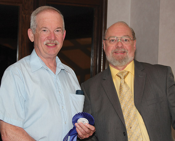 "Robert J. Graham receiving the Sheldon Carroll ""Best of Show"" Exhibit Award"