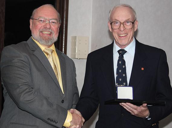 Tim Henderson (left) receiving the J. Douglas Ferguson Award from Ron Greene