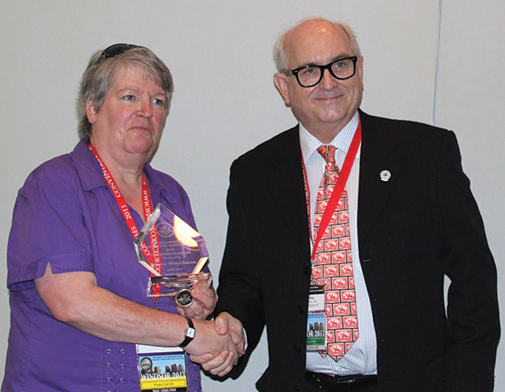 France Waychison (left) receiving a Presidential Award from Dan Gosling, President of the RCNA