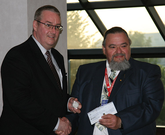 James Williston, Calgary Numismatic Society receiving the Louise Graham Memorial Club of the Year Award for 2011 from Bill Waychison