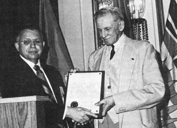 <p><strong>John Jay Pittman</strong> presenting the&nbsp;J. Douglas Ferguson Award&nbsp;to <strong>Guy Potte</strong>r at the 1971 C.N.A. Convention<br />(left to right)</p>